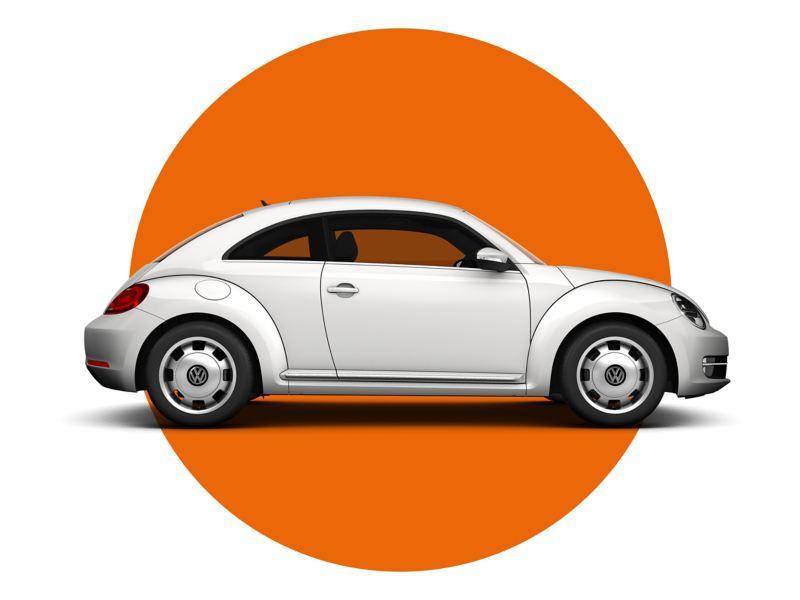 An approved used white VW beetle against an orange and white background