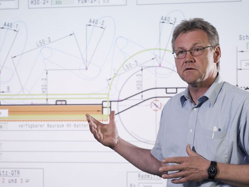A Volkswagen engineer standing in front of whiteboard