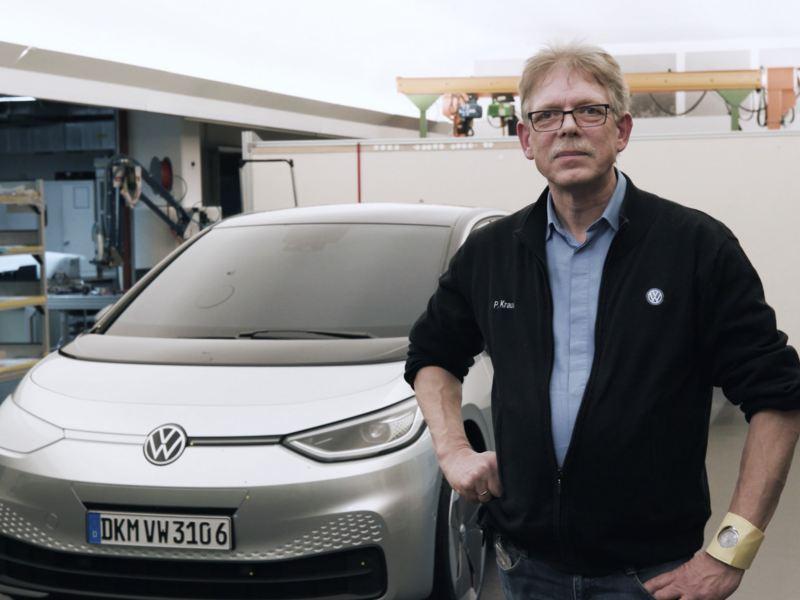 Volkswagen's Peter Kraus in front of a car.