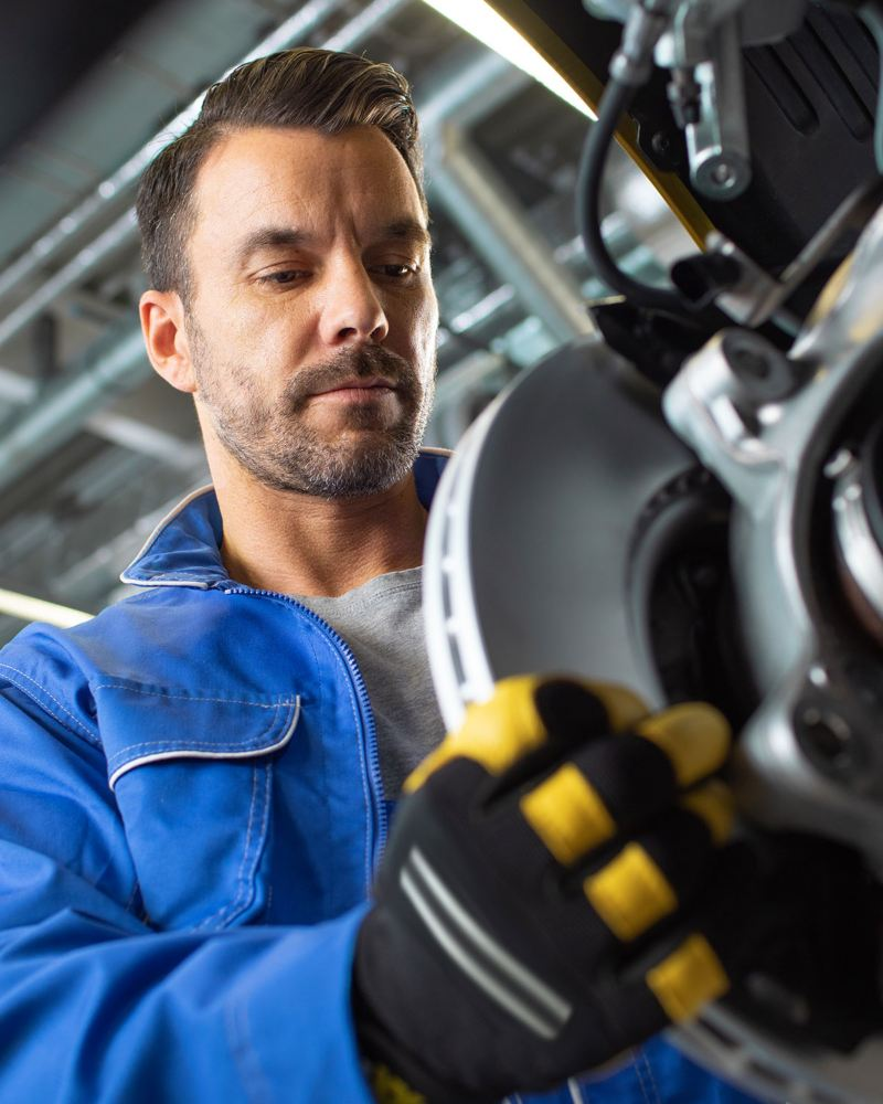 A VW employee changing the Volkswagen Brakes Disc