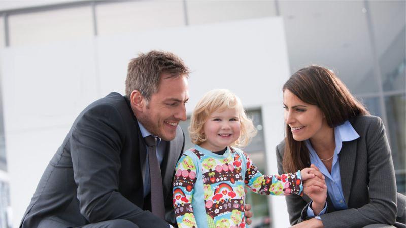 Happy family outside VW Van Centre