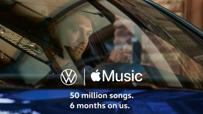 Apple Music logo on man listening behind the wheel
