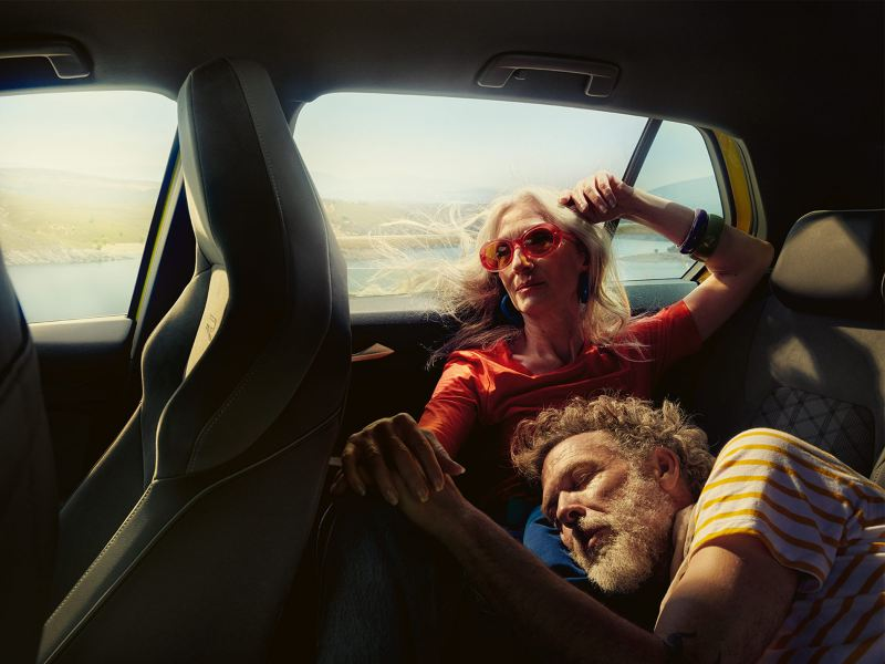 A couple relaxing in the car