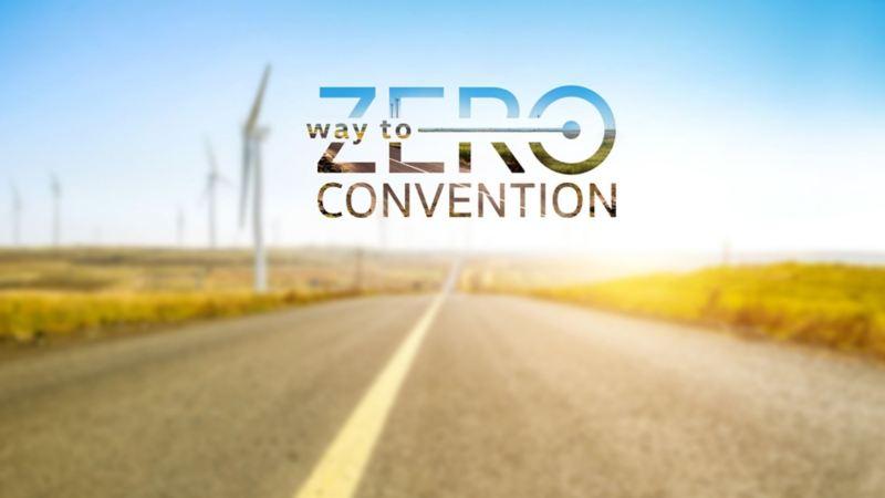 Campo eólico con logo de la convención way to zero