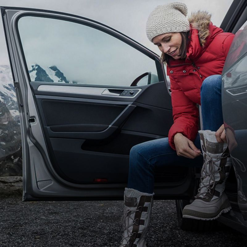 A woman is getting out of a car