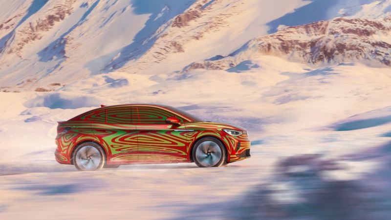 ID.5 Camouflage side view. Rides in snowy landscape.