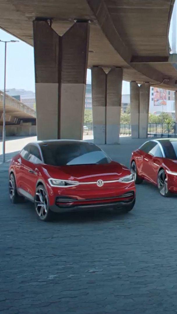 The Volkswagen ID. range lined up under an inner city bridge