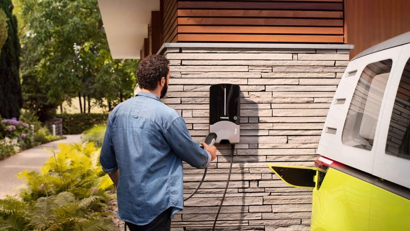 Man charging ID. Buzz van