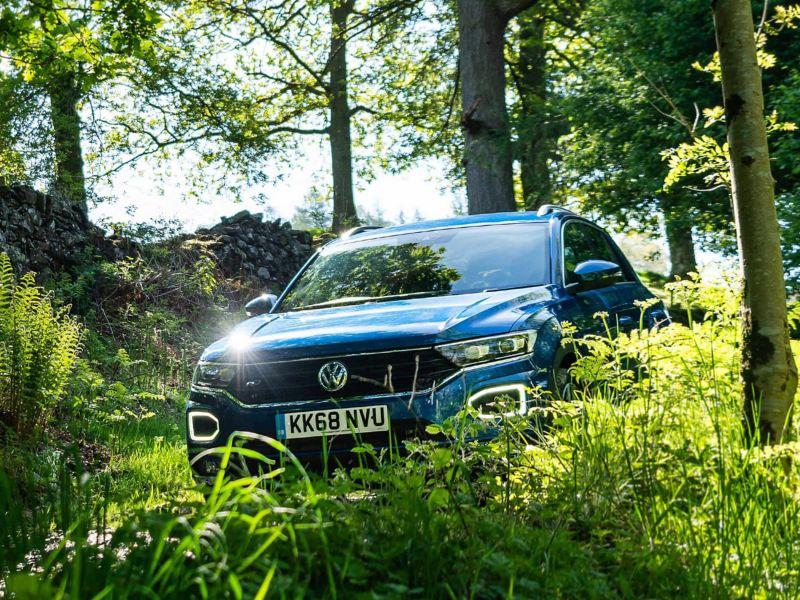 Volkswagen T-Roc parked in the woods