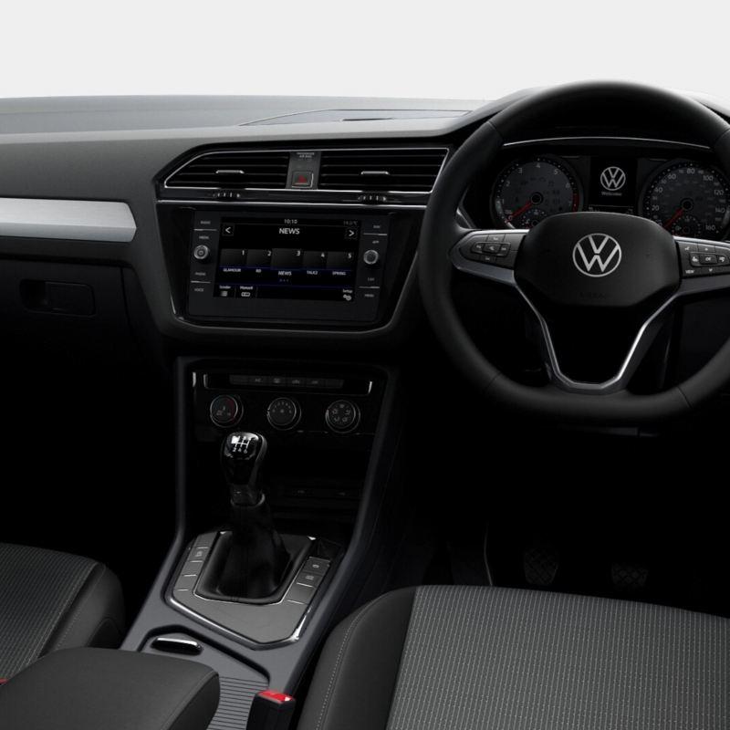 Interior shot of a Volkswagen, steering wheel and dashboard.