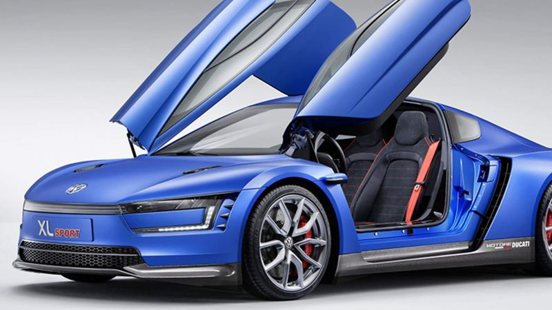 A parked XL1 Sport concept car with its wing doors open