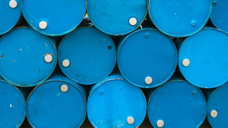Blue barrels  stacked sideways on top of each other