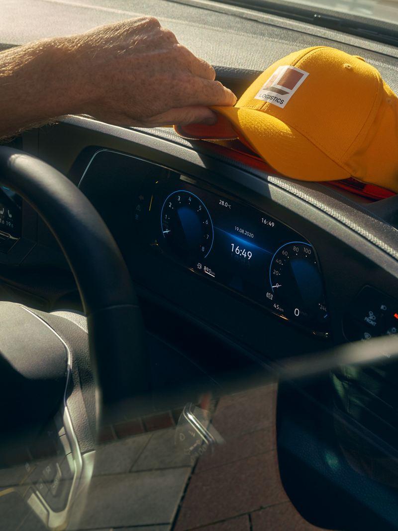 Courier placing cap onto dash of Volkswagen Caddy Cargo.