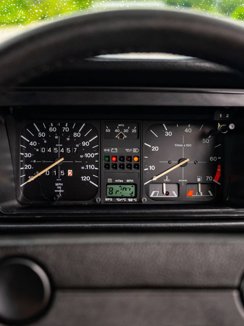 A close up of the steering wheel and speedometer in a Mk 1 VW Golf GTI