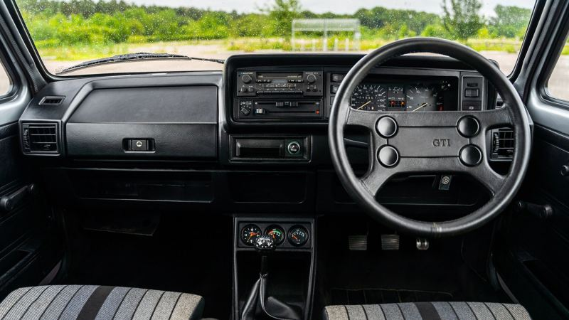 An interior shot of the front cabin of a Mk 1 VW Golf GTI