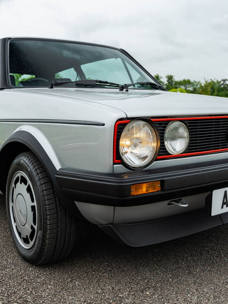 A front 3/4 shot of a silver Mk 1 VW Golf GTI