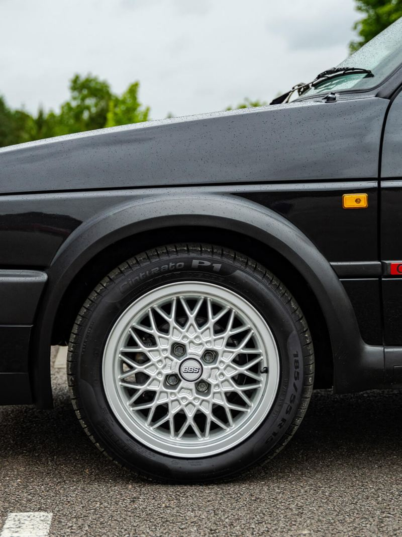 A side profile shot of a black Mk 2 VW Golf showing GTI logo and wheel