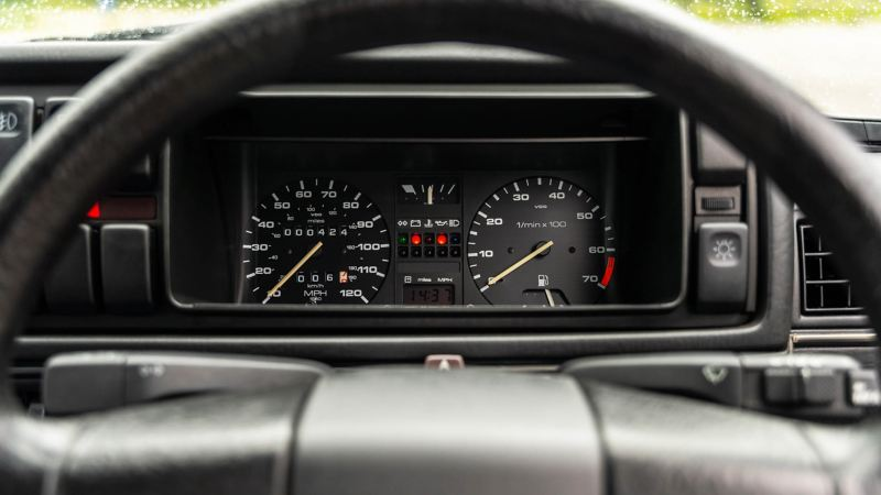 A close up of the steering wheel and speedometer in a Mk 2 VW Golf GTI