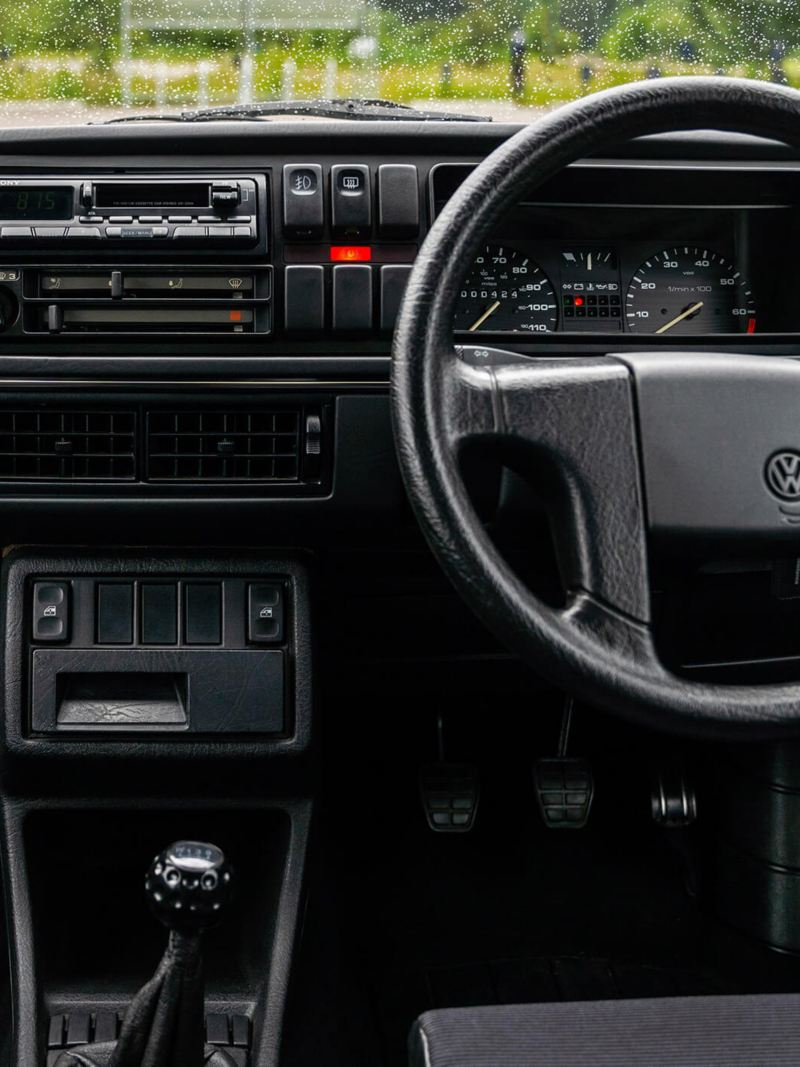 An interior shot of the front cabin of a Mk 2 VW Golf GTI