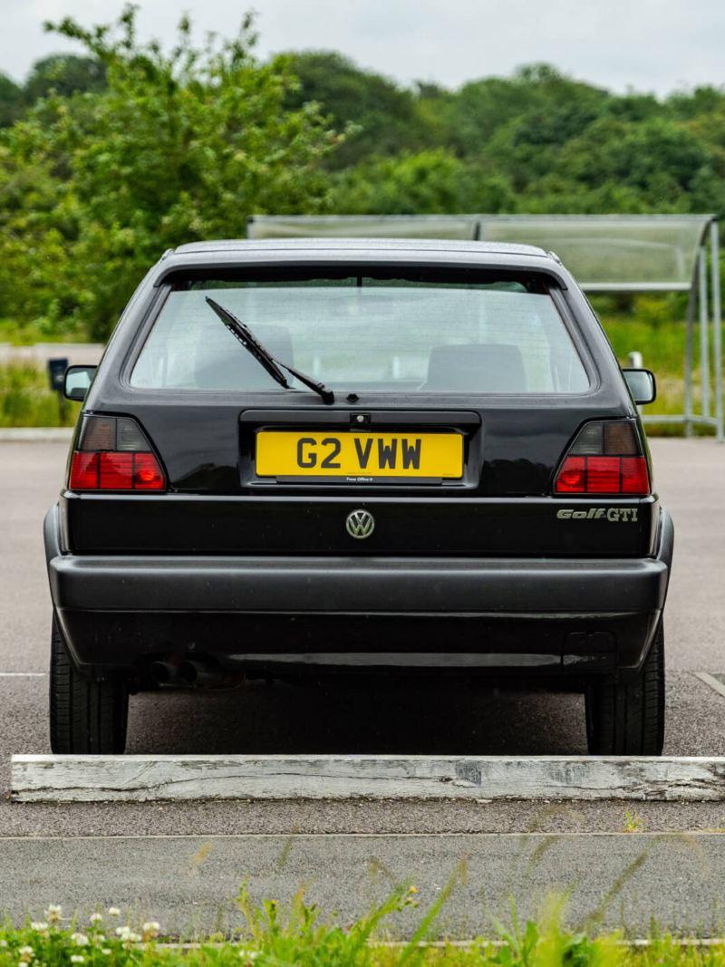 A rear shot of a black Mk 2 VW Golf GTI