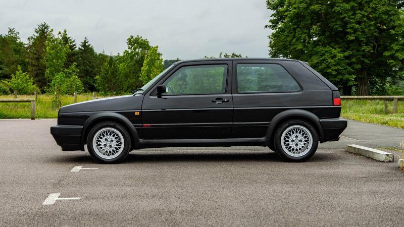 A side profile shot of a black Mk 2 VW Golf GTI