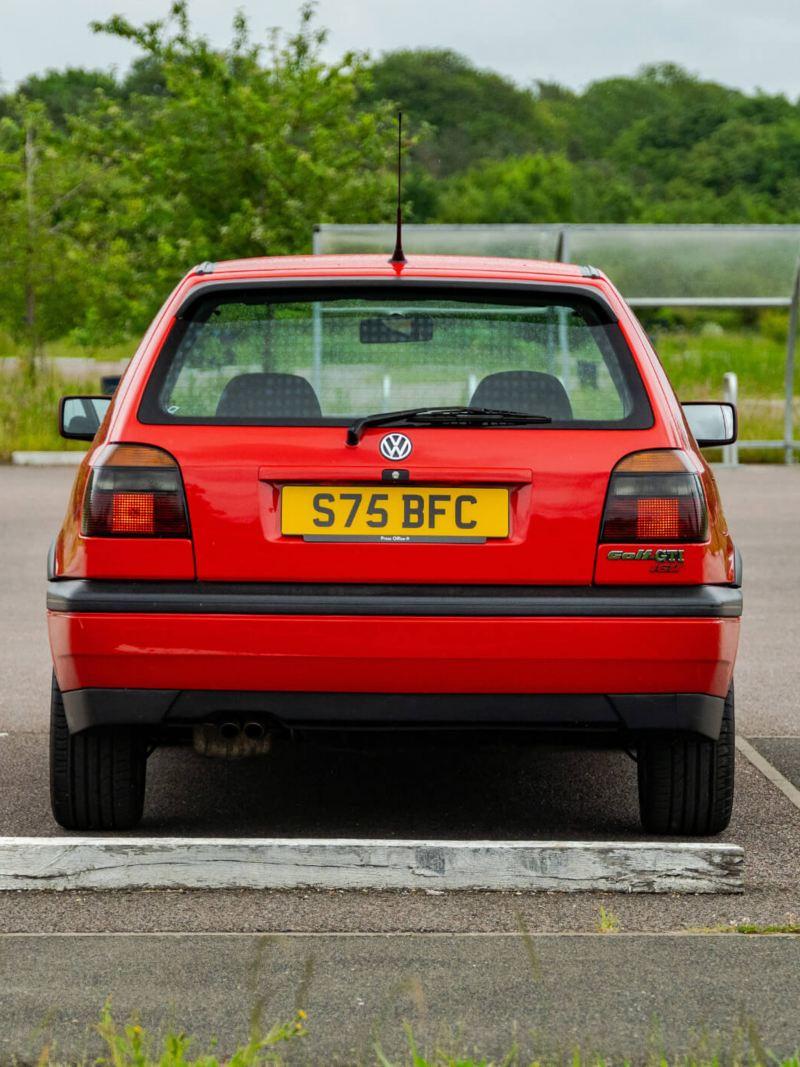 A rear shot of a red Mk 3 VW Golf GTI