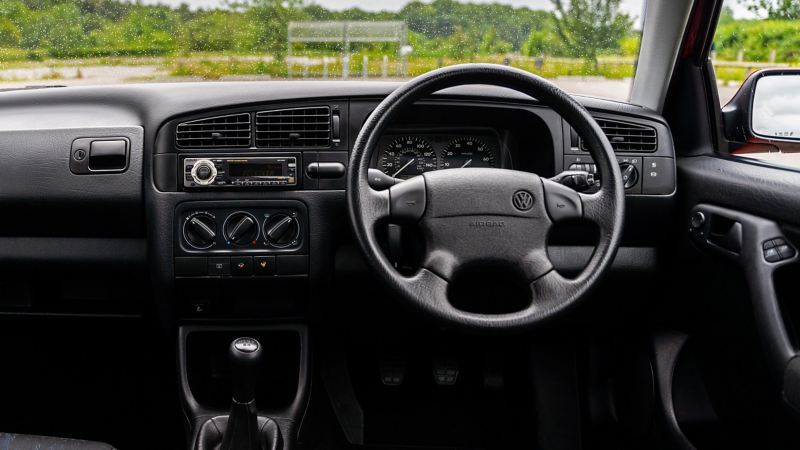 An interior shot of the front cabin of a Mk 3 VW Golf GTI