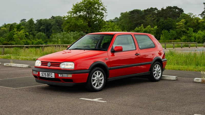 A front 3/4 shot of a red Mk 3 VW Golf GTI