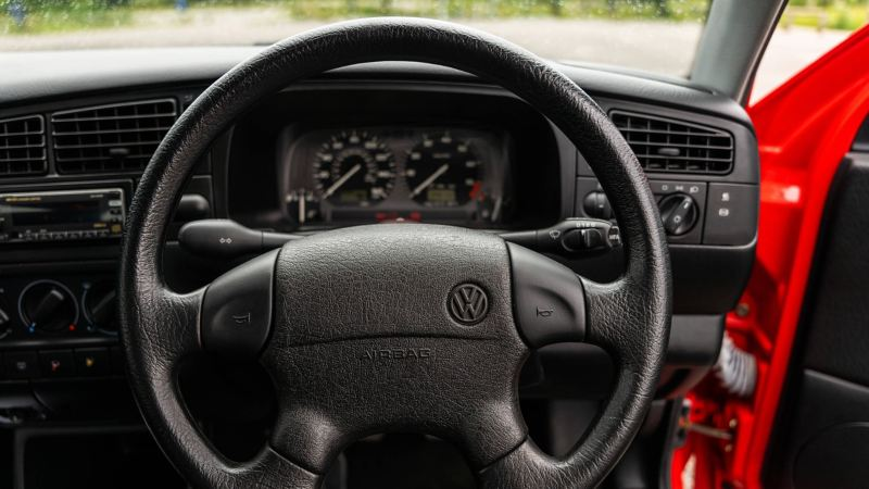 A close up of the steering wheel and speedometer in a Mk 3 VW Golf GTI