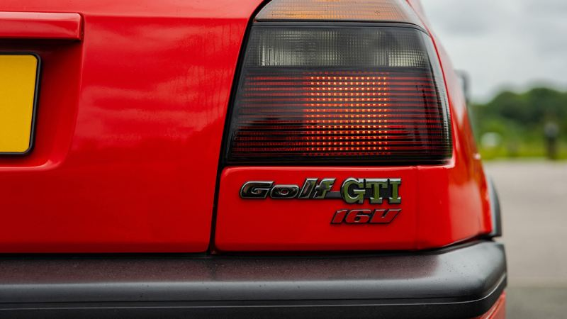 A rear shot of a red Mk 3 Golf GTI focussed on the logo