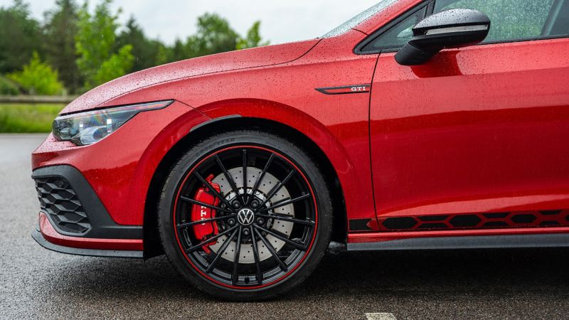 A side profile shot of a red Mk 8 VW Golf showing GTI logo and wheel
