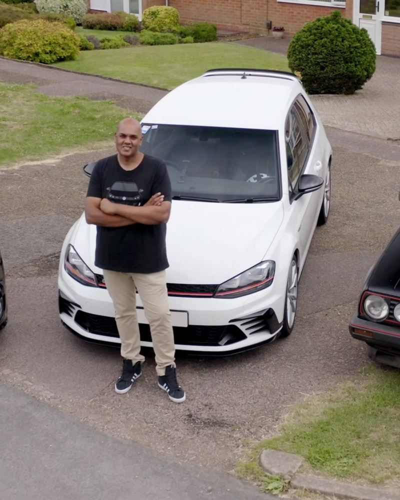 Chandrin stands in front of his Golf GTI collection