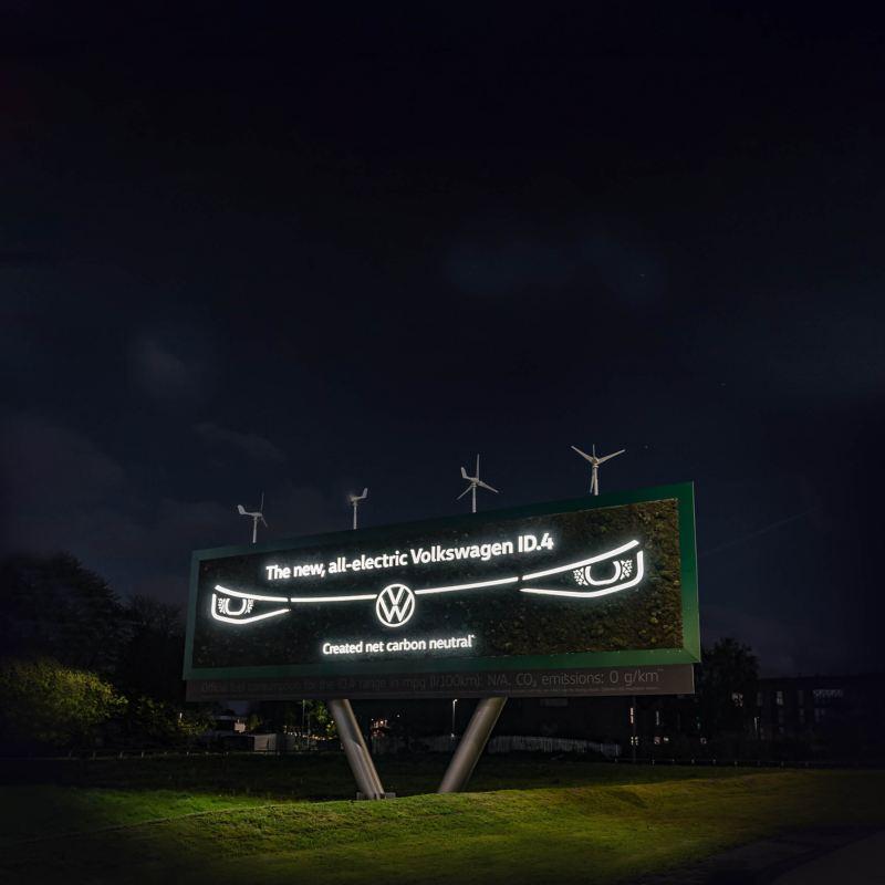 Living billboard at night showing motif of ID.4 headlight design illuminated
