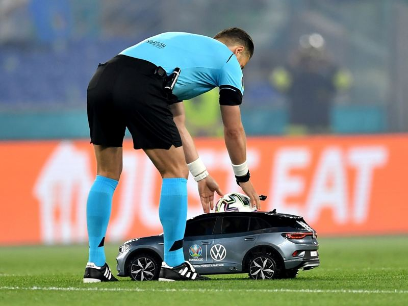 UEFA referee places football in tiny VW ID.4 before kick off