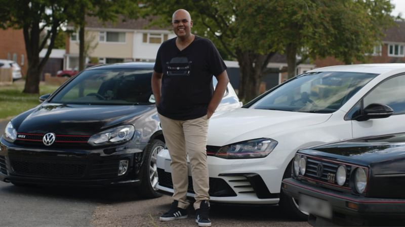 Chandrin stands in front of his white Golf GTI Mk7 Clubsport S