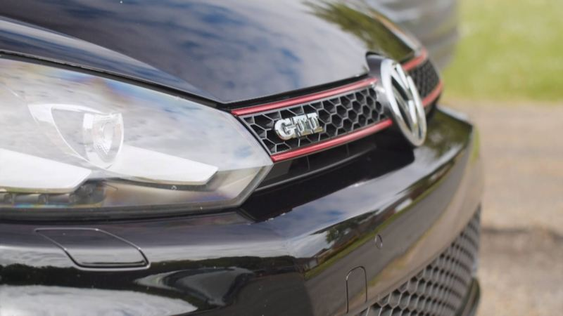 The front grille of a black Golf GTI MK6