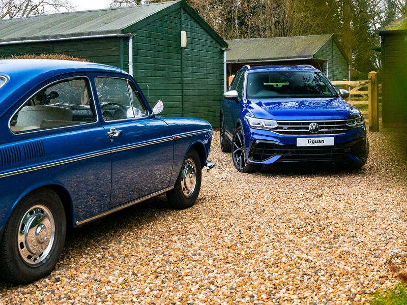 A blue retro VW next to the new Tiguan VW