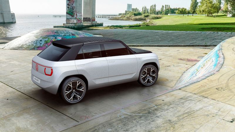 A CGI mock-up of the VW ID. Life concept car in a futuristic urban environment