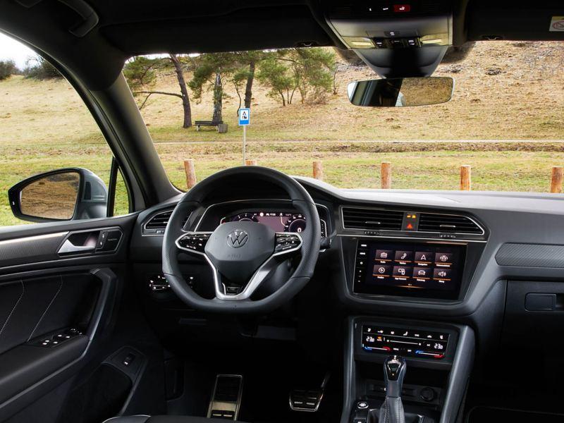 Interior shot of a Volkswagen Tiguan Allspace, steering wheel and dashboard.