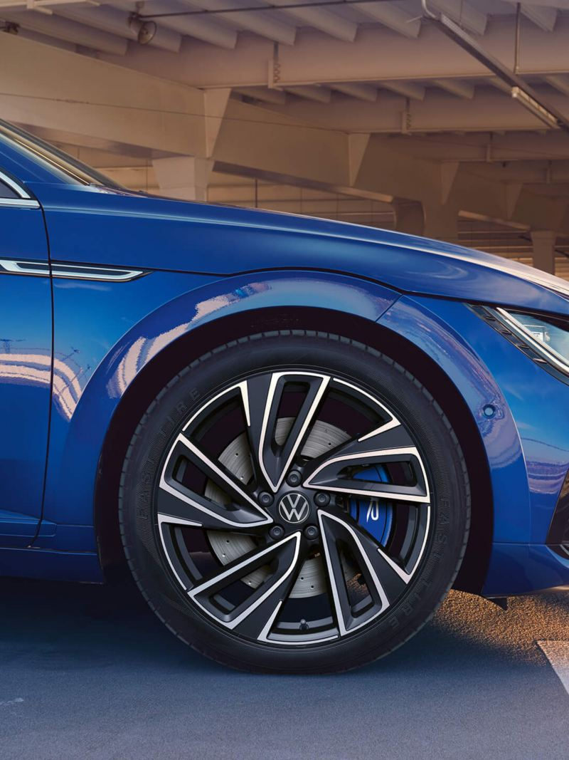 A blue VW Arteon R Shooting Brake with sporty rims