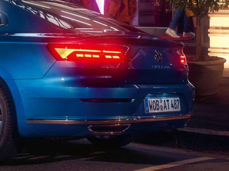 An image showing the tail lights of a New Arteon with the break lights on.