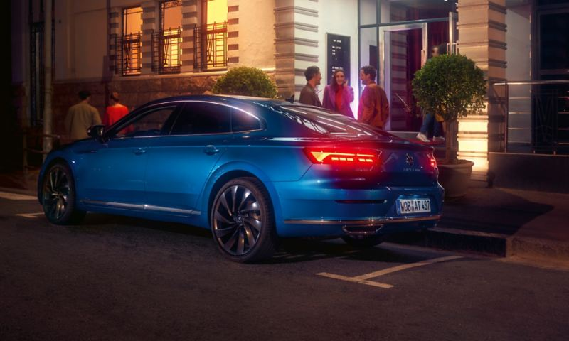 Three friends stood out a Volkswagen New Arteon