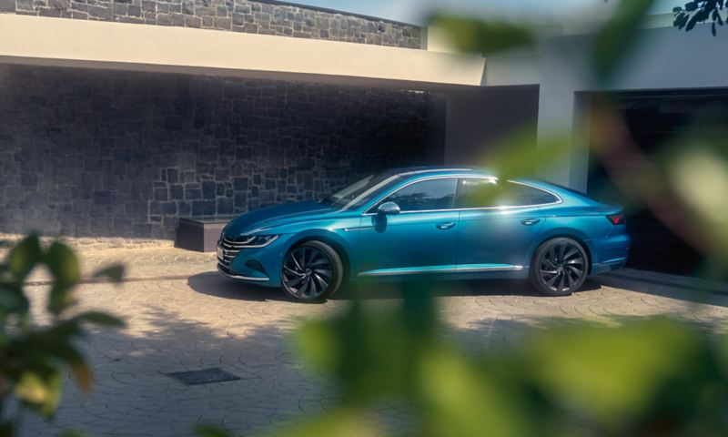The Arteon parked on a driveway