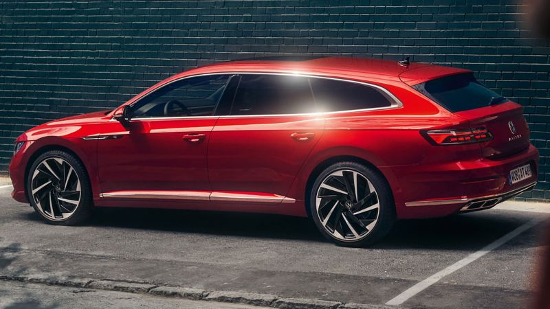 A red Arteon Shooting Brake parked against a wall