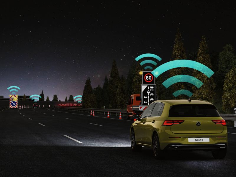 Yellow Golf communicating with hazards and cautions on the road using Car2X technology.