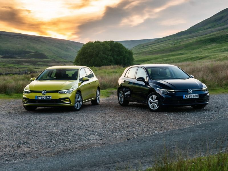 2 Golf 8s parked in the countryside