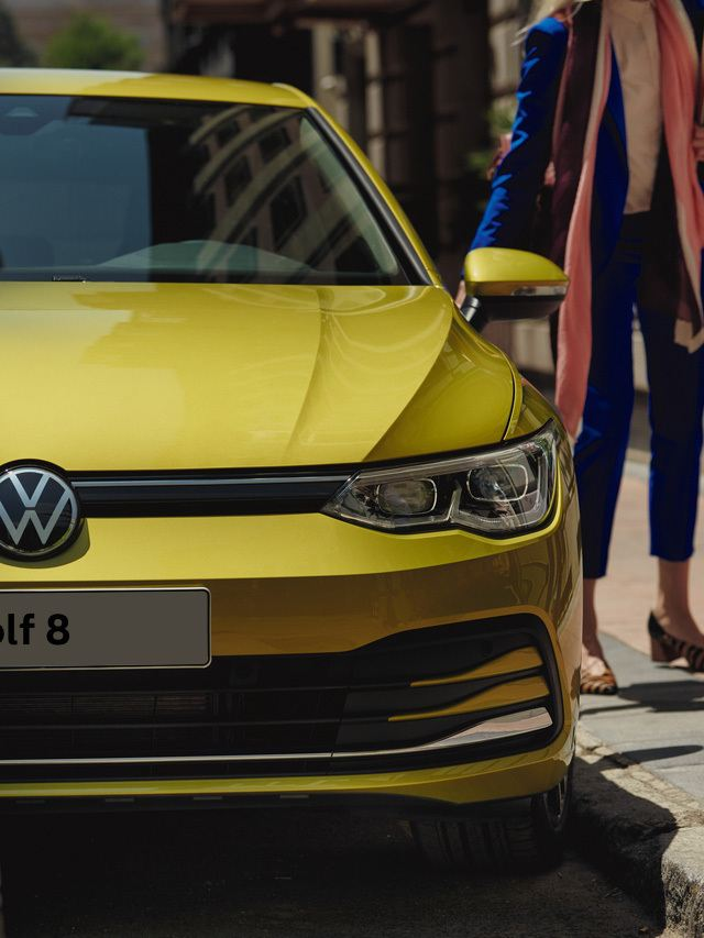 Front image of yellow Golf 8.