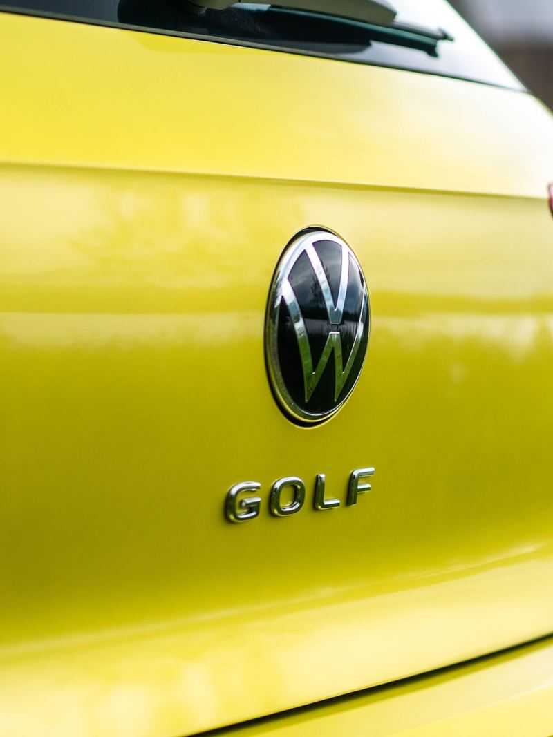 The Golf badge on a yellow Golf 8