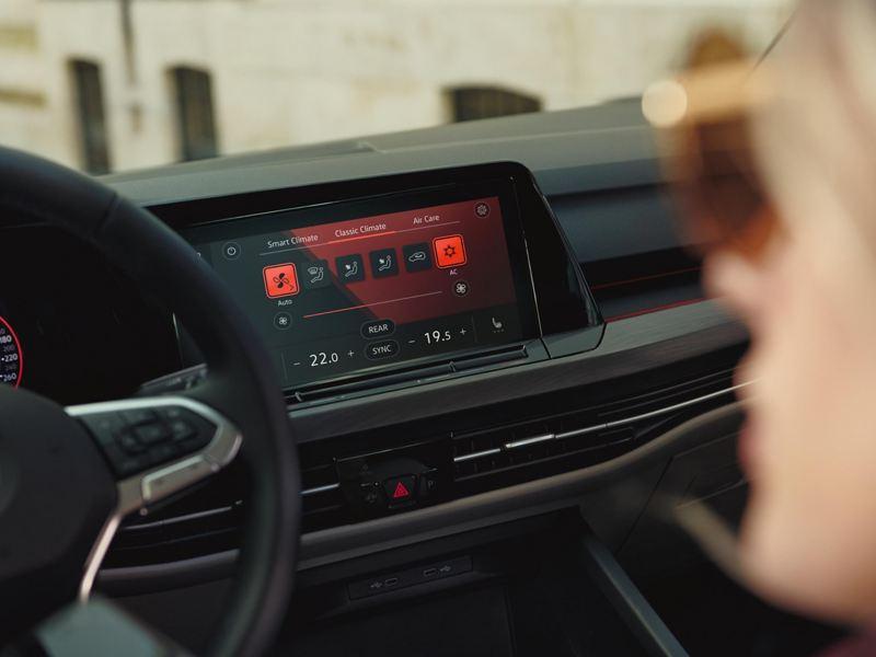 Interior shot of a Volkswagen Golf 8, steering wheel and dashboard.