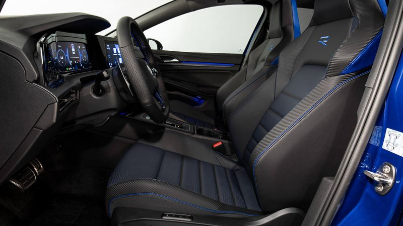 Golf R from inside with sports seats. View through the driver's door.
